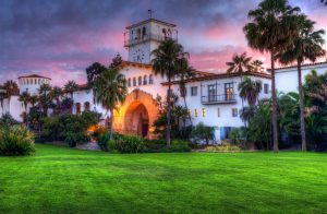 The Santa Barbara Courthouse under a pink sunset with clouds.