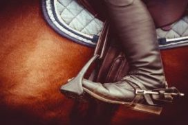 View of a horseback rider's boot in a stirrup