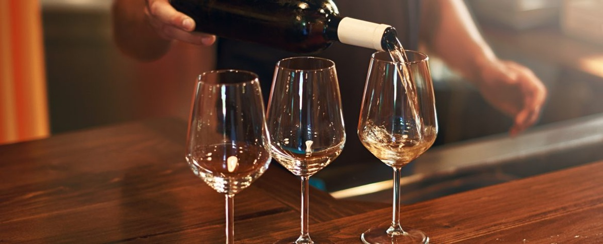 Sommelier fills the glasses during pinot gris wine tasting at a winery on The Urban Wine Trail in Santa Barbara.