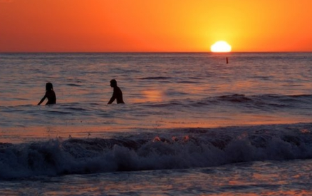 Surfing silhouettes at sunset at Arroyo Burro County Park